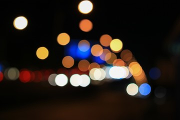 Abstract blurred bokeh in city night  colorful beautiful of traffic in Bangkok Thailand, with copy space