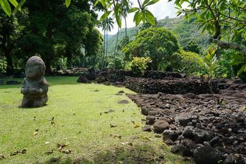 Polynesian old stone structure and statue, sacred place marae Arahurahu on Tahiti island, French Polynesia, Oceania