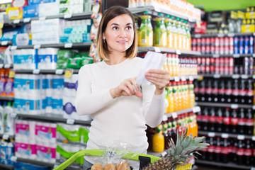 Female shopper checking shopping list