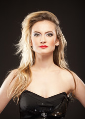 Young Woman with Blond Hair and Disco Makeup.