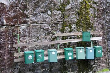 Mailboxes at mountain rock wall
