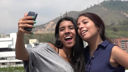 Teen Female Friends Taking A Selfie