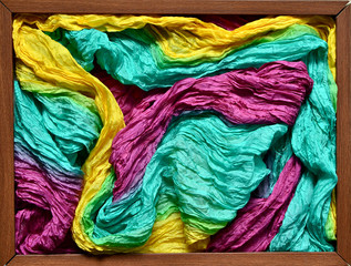 Wooden frame filled with multicolored silk headscarf