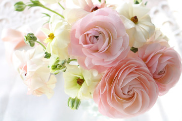 Bouquet of beautiful ranunculus flowers in vase on white background,ラナンキュラスのアレンジメント