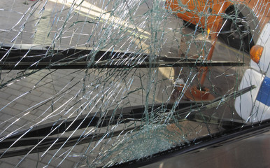 unbreakable frontal glass damaged by crash in a public transport bus