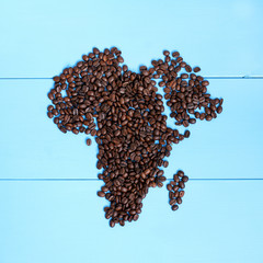 African black coffee/ flat layout of roasted grains forming outline the continent