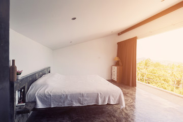 Bed room minimalism interior with cement floor, big open balcony and design elements