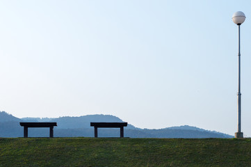 Bench on top of the mountain view background