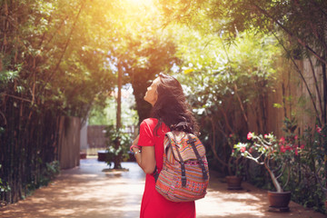 Young asian woman travel with backpack in city