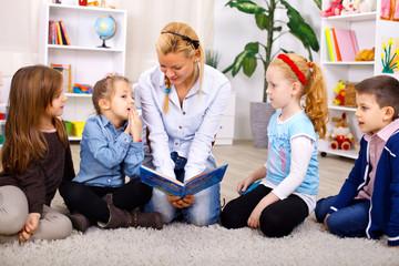 Teacher telling story to children