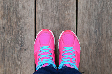 Pink Sport Shoe On Wood Slat Floor