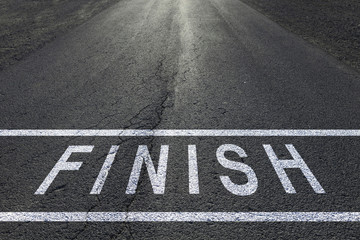 Sunny finish line racing background on asphalt floor.