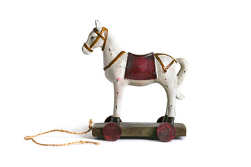 Wooden toy horse on a platform with wheels