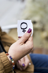woman with a female gender symbol