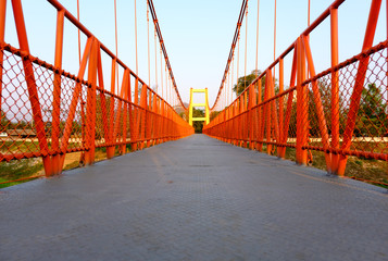 Red Suspension bridge, Crossing the river