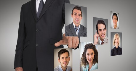 Businessman touching profile pictures of business executives
