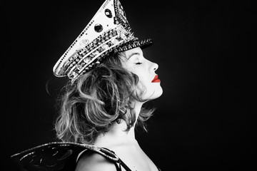 fashion portrait  glamour luxury woman singer in dark studio background. Black and white portrait with red lips