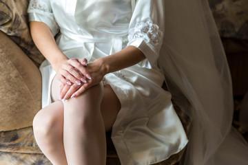 Bride hands on knees
