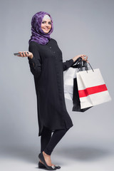 Muslim woman goes shopping