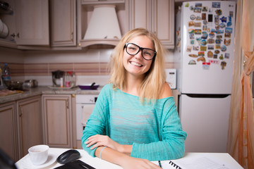 Happy woman working with papers