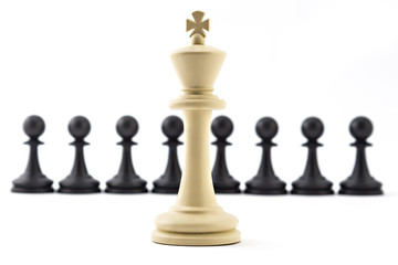 Chess business concept, leader & success. White king in front of black pawns