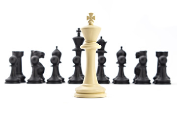 Chess business concept, leader & success. Black king and queen above defeated white king