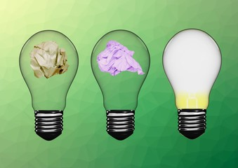 Electric bulbs with crumpled paper against green background