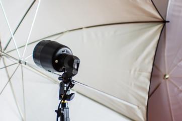 Studio photo flash and umbrellas