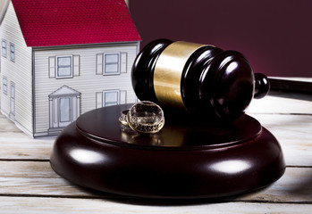 Family law concept, gavel, house and rings
