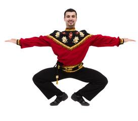 young man wearing a folk russian costume posing