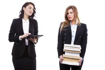 beautifull office secretaries with their E-Book and Books - E-Book vs Books