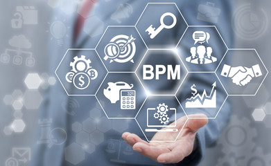 BPM: Business Process Management concept. Company Strategy, Marketing, Development technology. Businessman offer bpm icon on virtual screen.