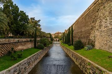 bridge on a canal in a mediterranean park