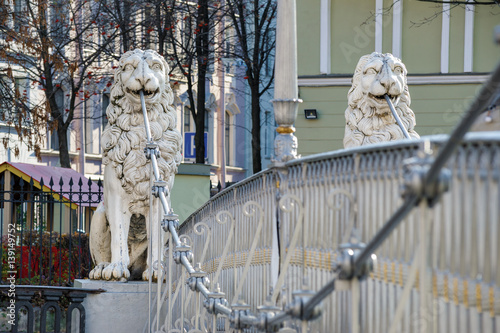 Statues of lions on the bridge over Griboyedov canal, St Petersburg, Russia