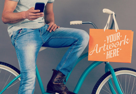 Person Sitting on Bike with Shopping Bag Mockup 1