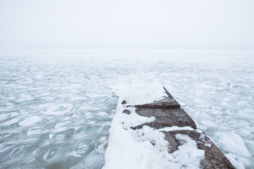 frozen sea in winter. Iced sea and covered with untouched snow
