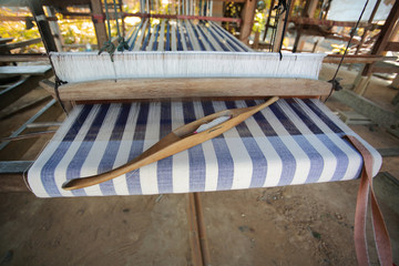 Traditional Thailand weaving loom made from timber and bamboo for making clothes,color toned.
