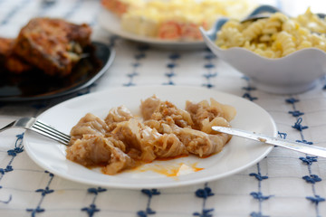 Serbian specialty sarma in the white plate chopped