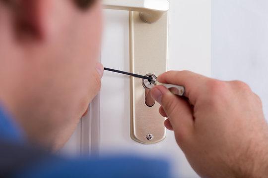 Lockpicker Hand Fixing Door Handle At Home