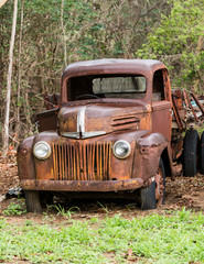 Rusty old Ford truck abandoned