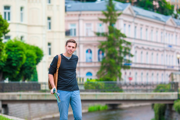Young urban boy on vacation exploring city in Europe