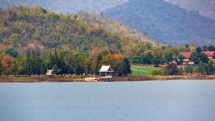 temple with forest conservation beside of reservoir.
