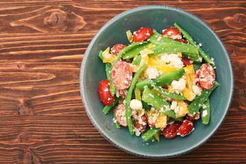 Snow pea salad with feta, tomato and pepper