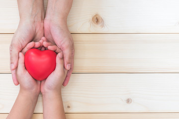 I love you Mom, Mother's Day celebration with woman holds young kid's hands supporting red heart.  Nursing children home day healthcare concept: Hospital medical business