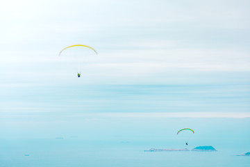 Paragliding above the ocean