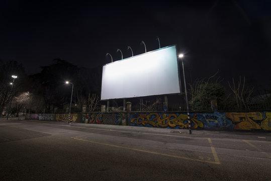 Blank billboard at night time.
