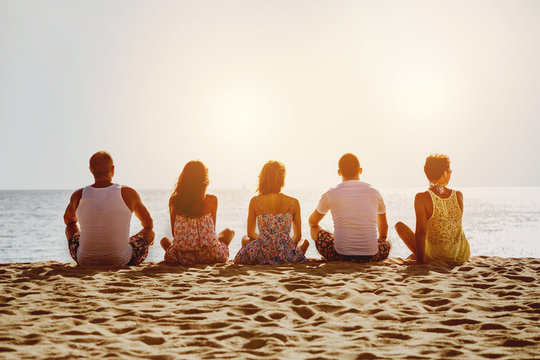 Group of five friends on beach