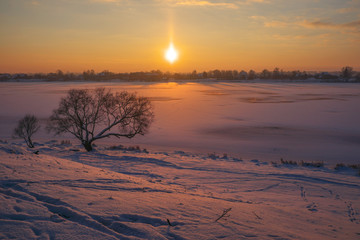 Winter landscape at warm sunset in amazing light