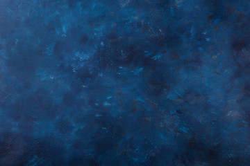 Dark blue stone background with high resolution. Top view. Copy space