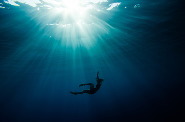 girl dive underwater